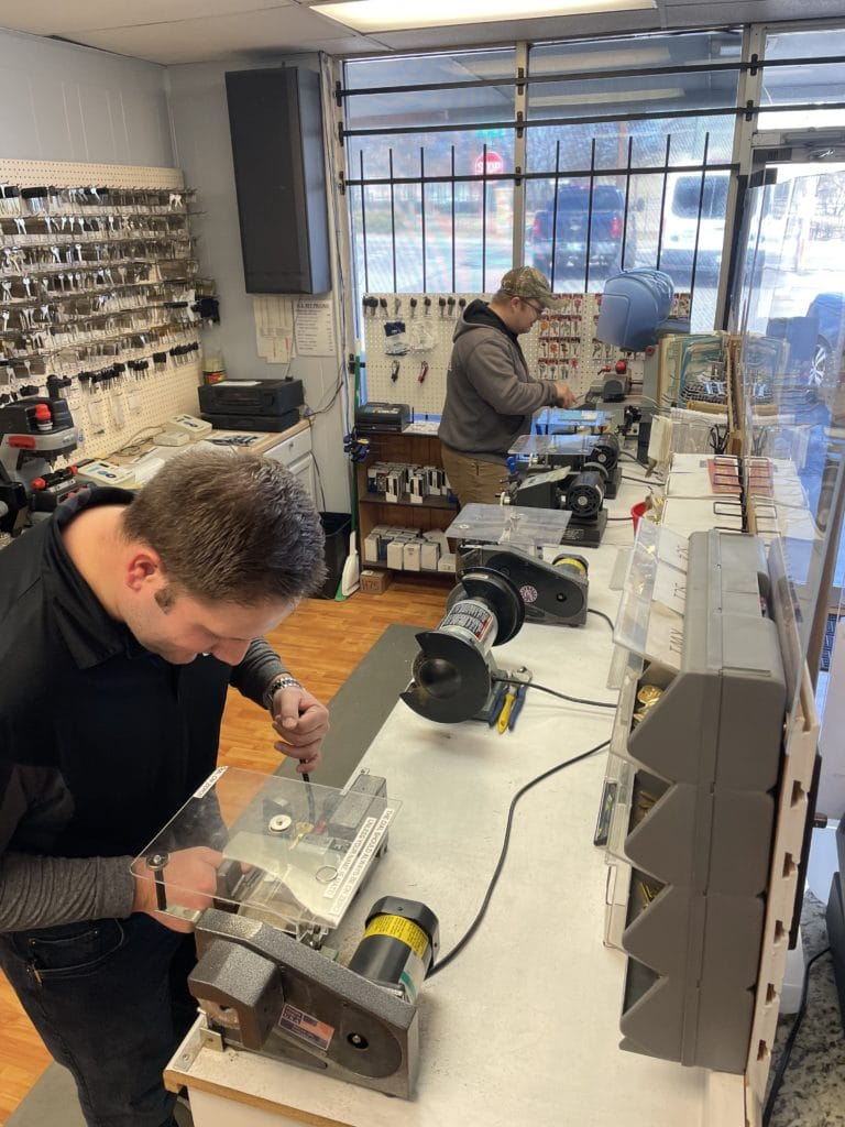 Admiral technicians using key cutters in the showroom