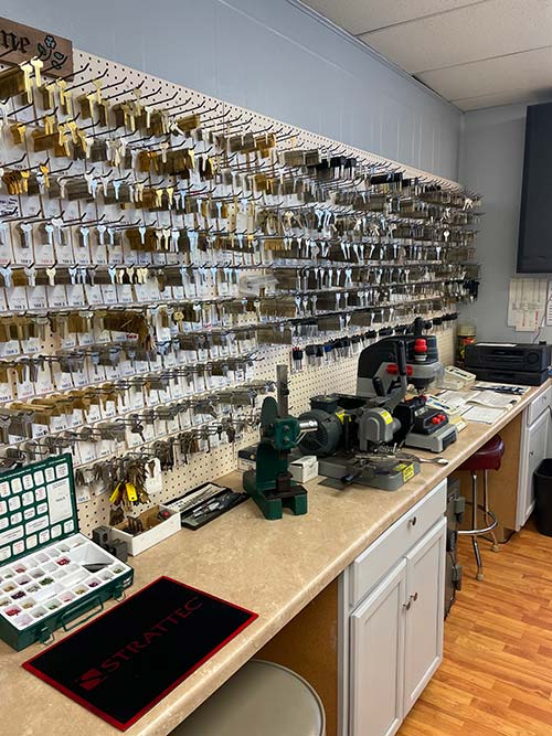 wall of key blanks and some key cutters in our showroom